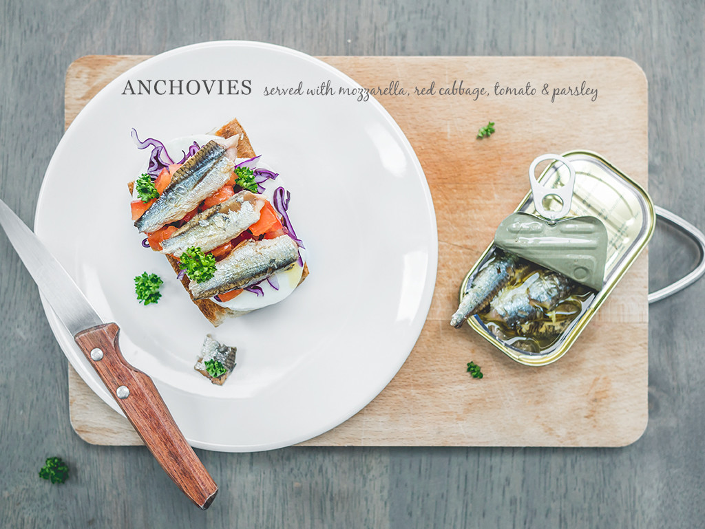 fresh anchovies served with mozzarella, red cabbage, tomato and parsley | curatedlifestunio.com