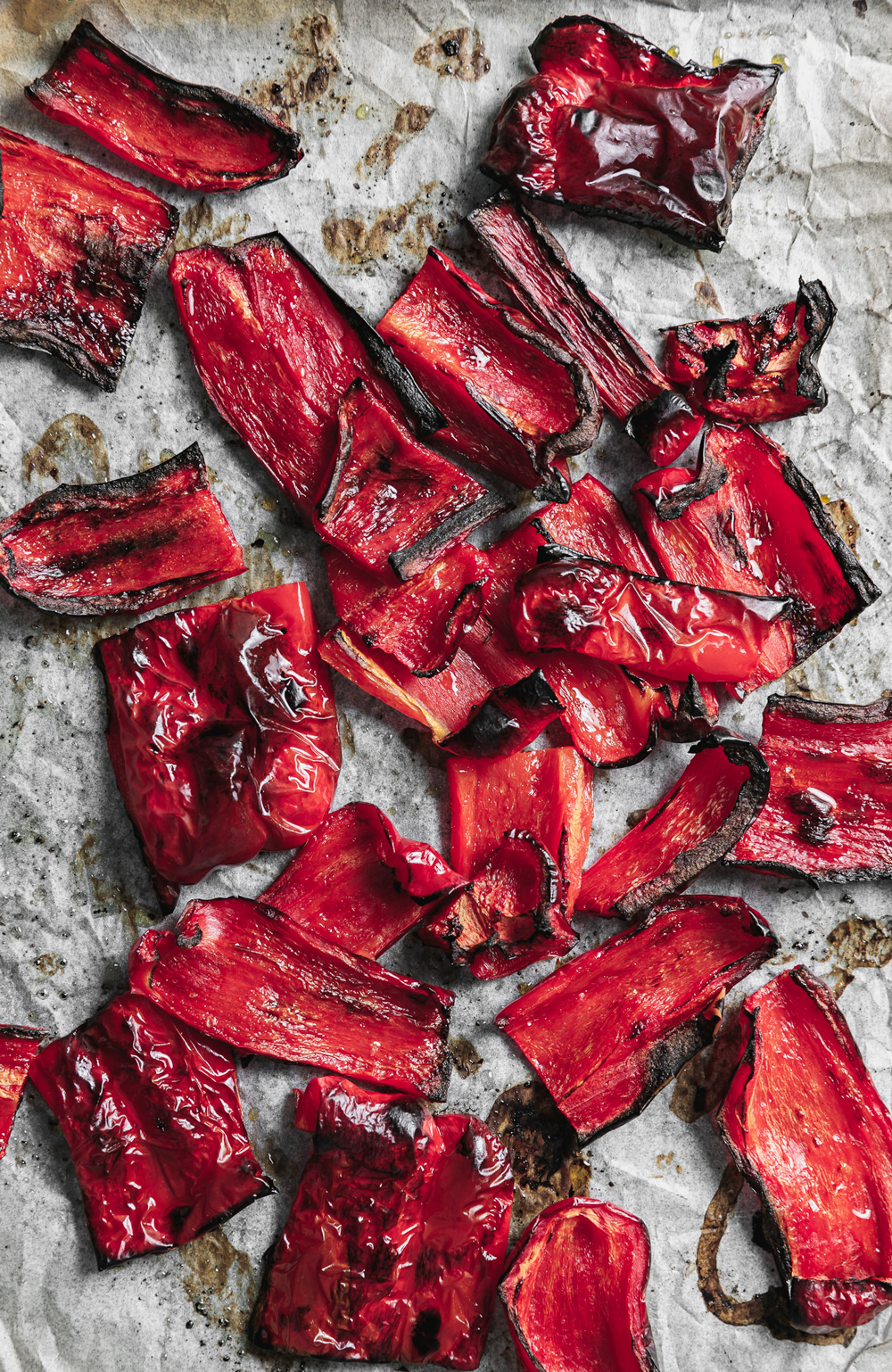 Roasted capsicum sitting on a baking tray