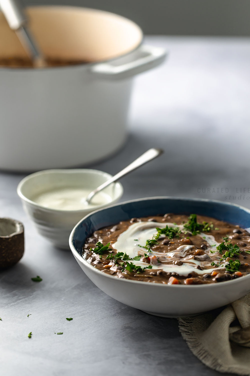 This Black Bean Soup recipe is not only filling, it's healthy, vegan and gluten free! Simple to prepare and perfect comfort food for dinner!  (Although inspired by the Hungarian recipe, included in this post are variations to transform this recipe into a Mexican or Cuban Soup Recipe!)  #Black-Bean #Soup #Simple #Easy #Vegan #Healthy #Dinners #Comfort-Foods #Gluten-Free #Mexican #Cuban #Hungarian