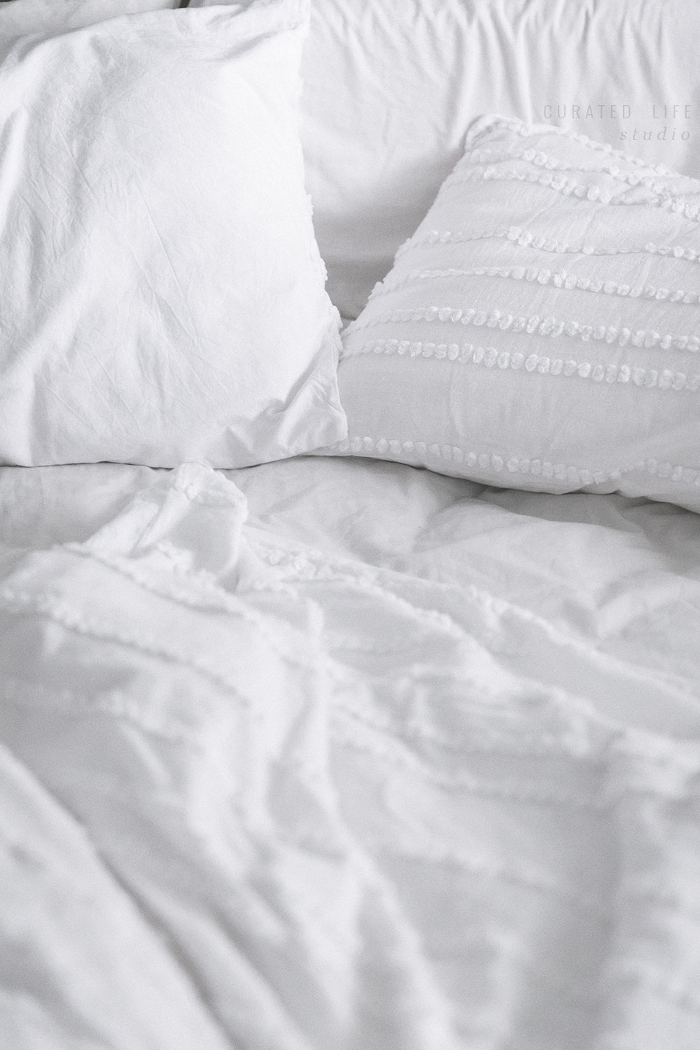 A close up of the bedlinen messily scattered over the bed. Breakfast is finished and the day now begins.